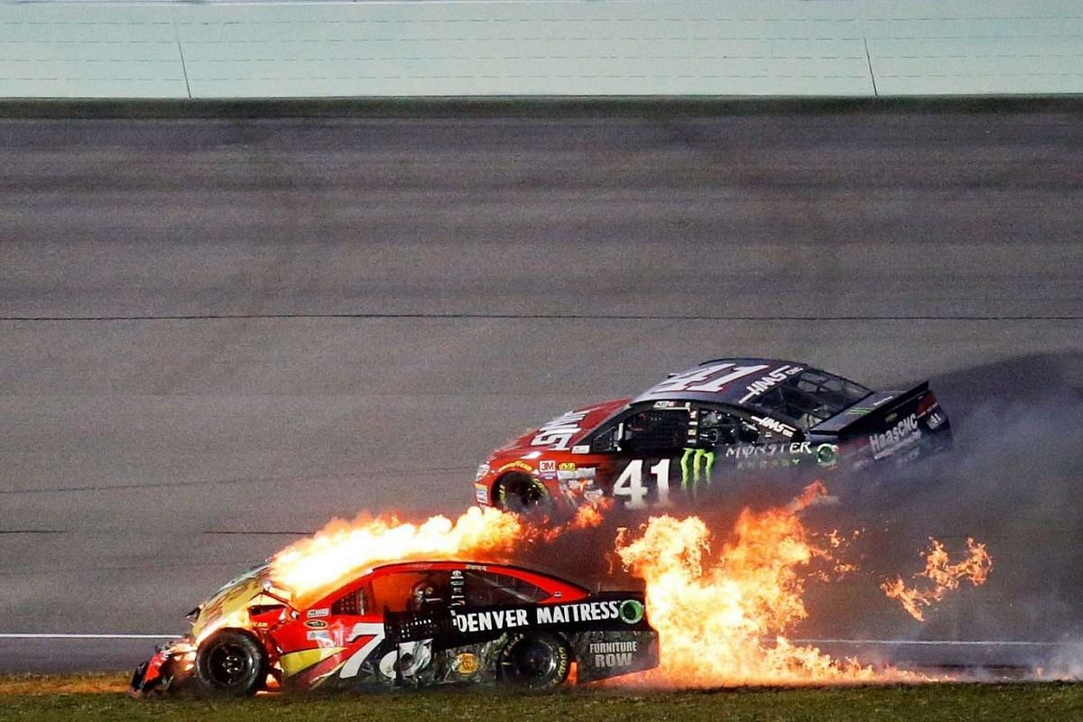 Martin Truex Jr, driver of the #78 Bass Pro Shops/Tracker Boats Toyota, is involved in an on-track incident during the Nascar Sprint Cup Series Ford EcoBoost 400 at Homestead-Miami Speedway on Nov 20, 2016.