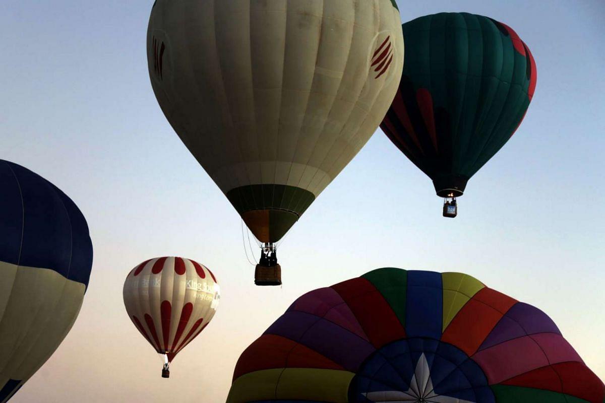Hot air balloons fly during the XV International Balloon Festival at the Metropolitan Park in Leon, Mexico on Nov 20, 2016.