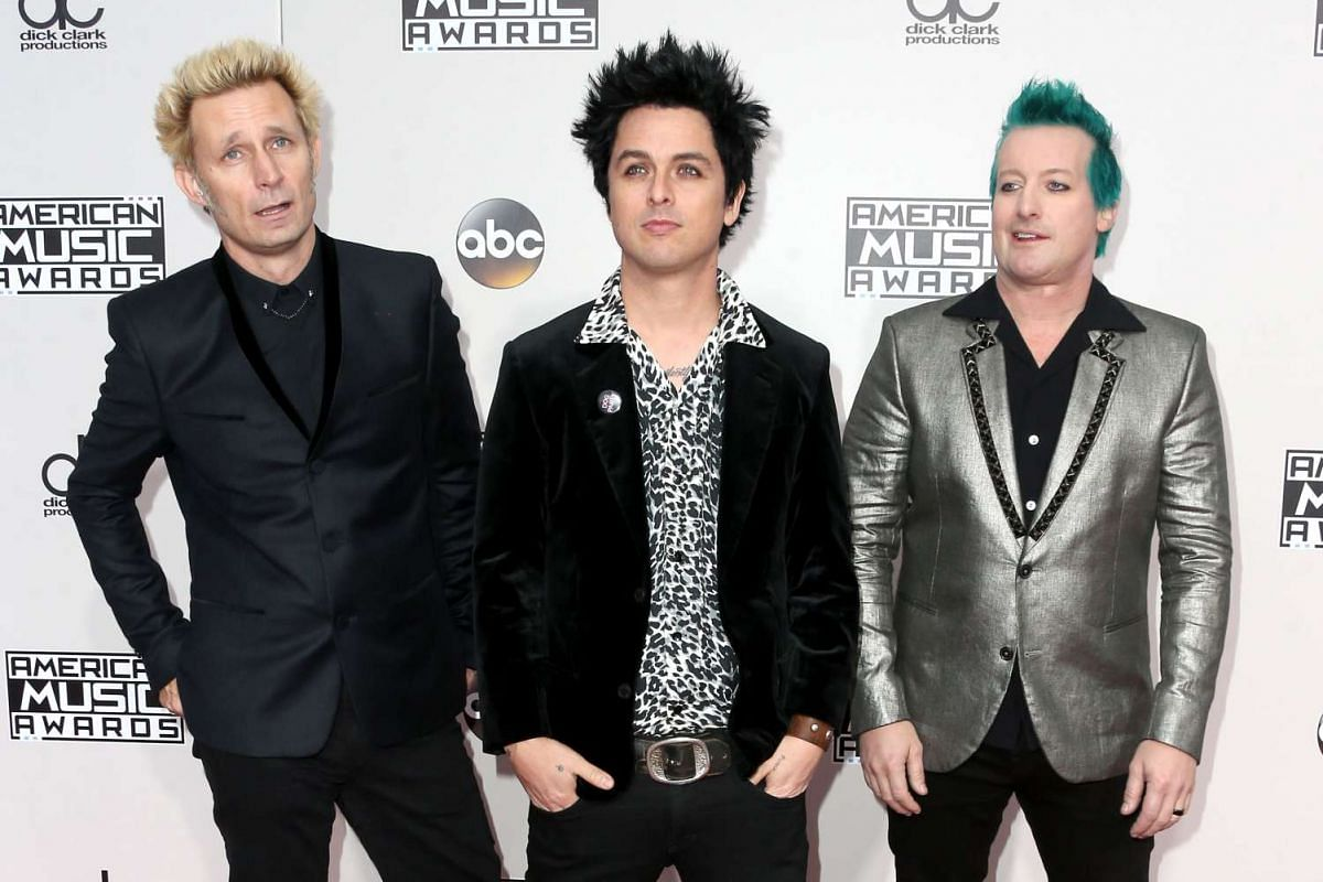 Musicians Mike Dirnt, Billie Joe Armstrong and Tré Cool of Green Day attending the American Music Awards in Los Angeles, California. on Nov 20, 2016.
