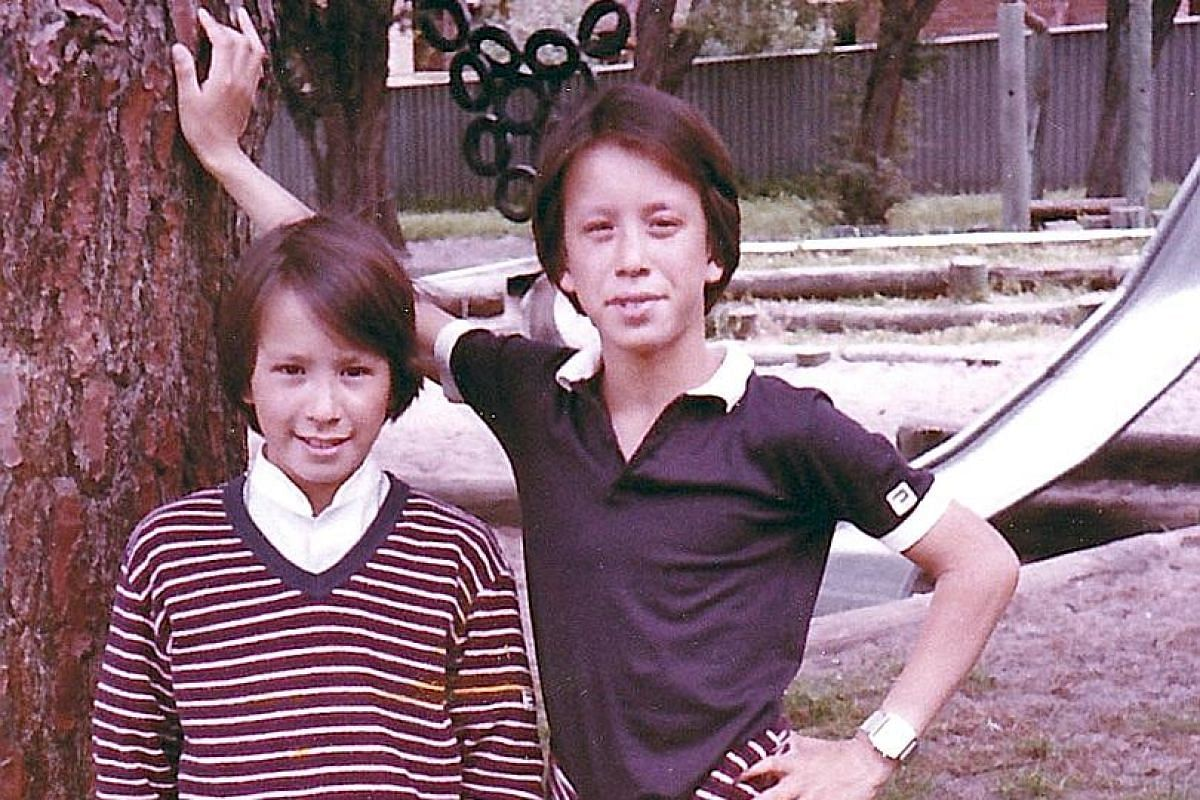 Julian (left), 10, and Christian Tan, 12, in Perth where they grew up.