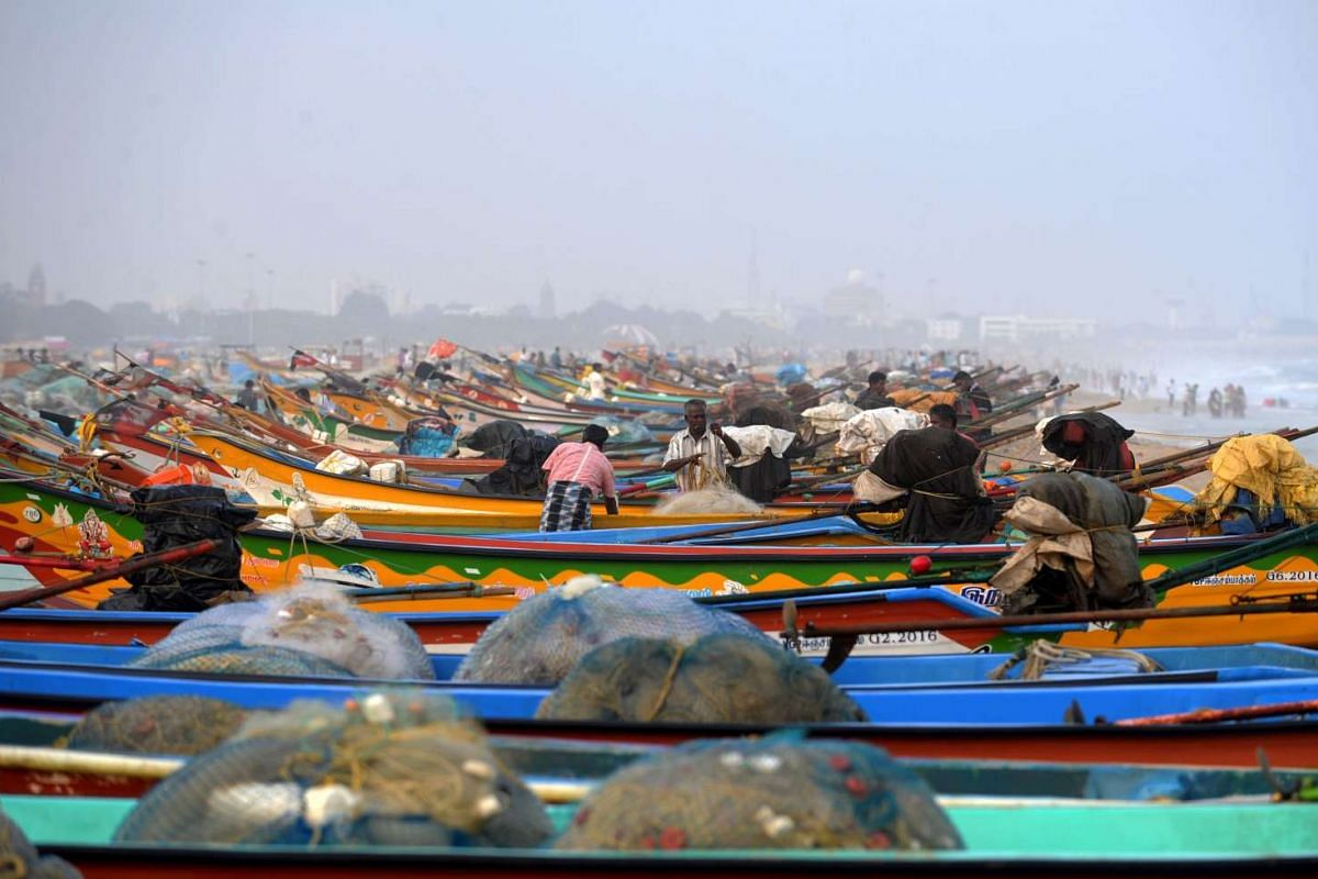 Indian fisherman arrange their nets as fishing ferries line up on the ocassion of International Fishermans day, on the coast of the Bay of Bengal in Chennai on Nov 21, 2016.