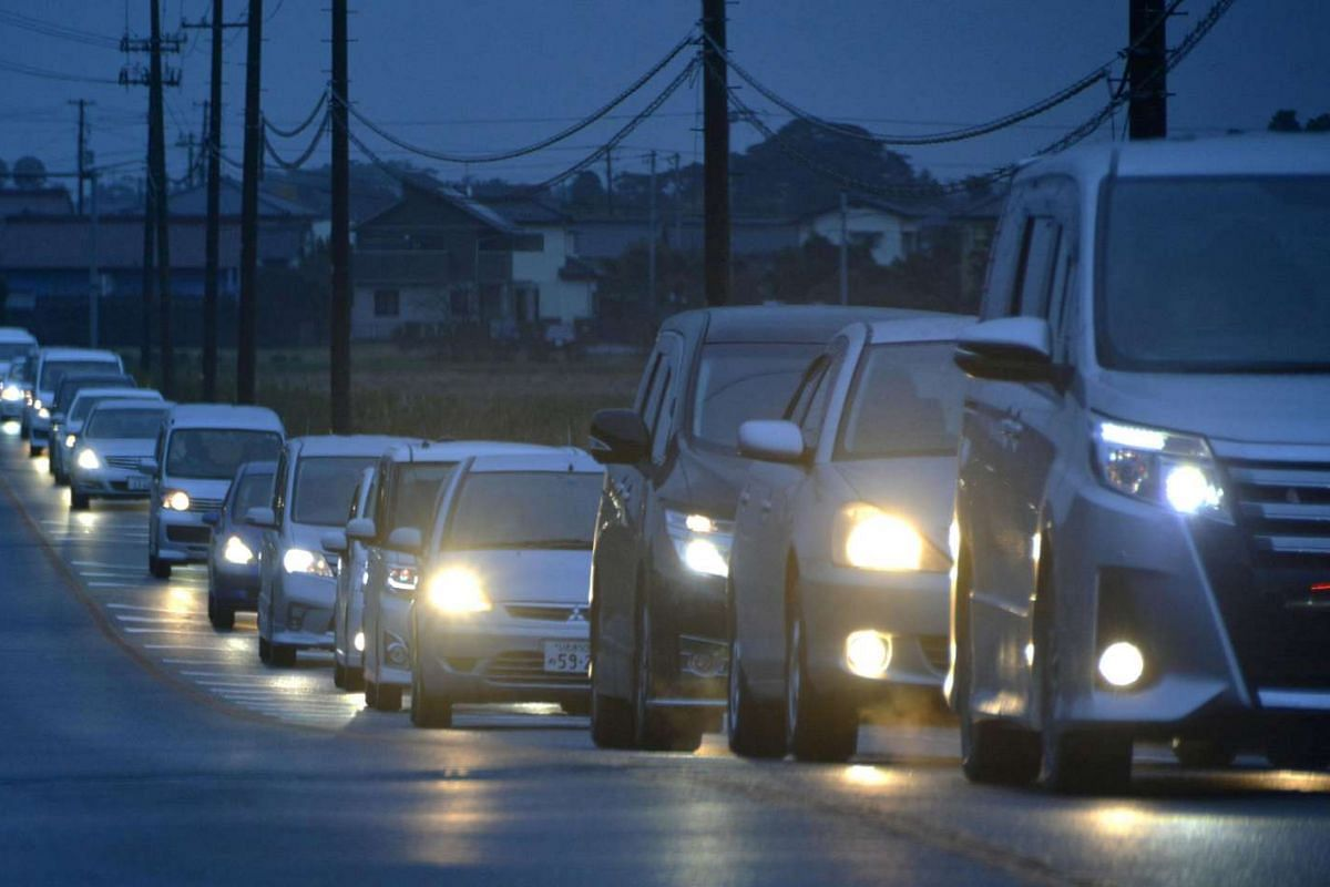 A traffic jam is seen as people evacuate after tsunami advisories were issued following an earthquake, in Iwaki, Fukushima prefecture, Japan, on Nov 22, 2016.