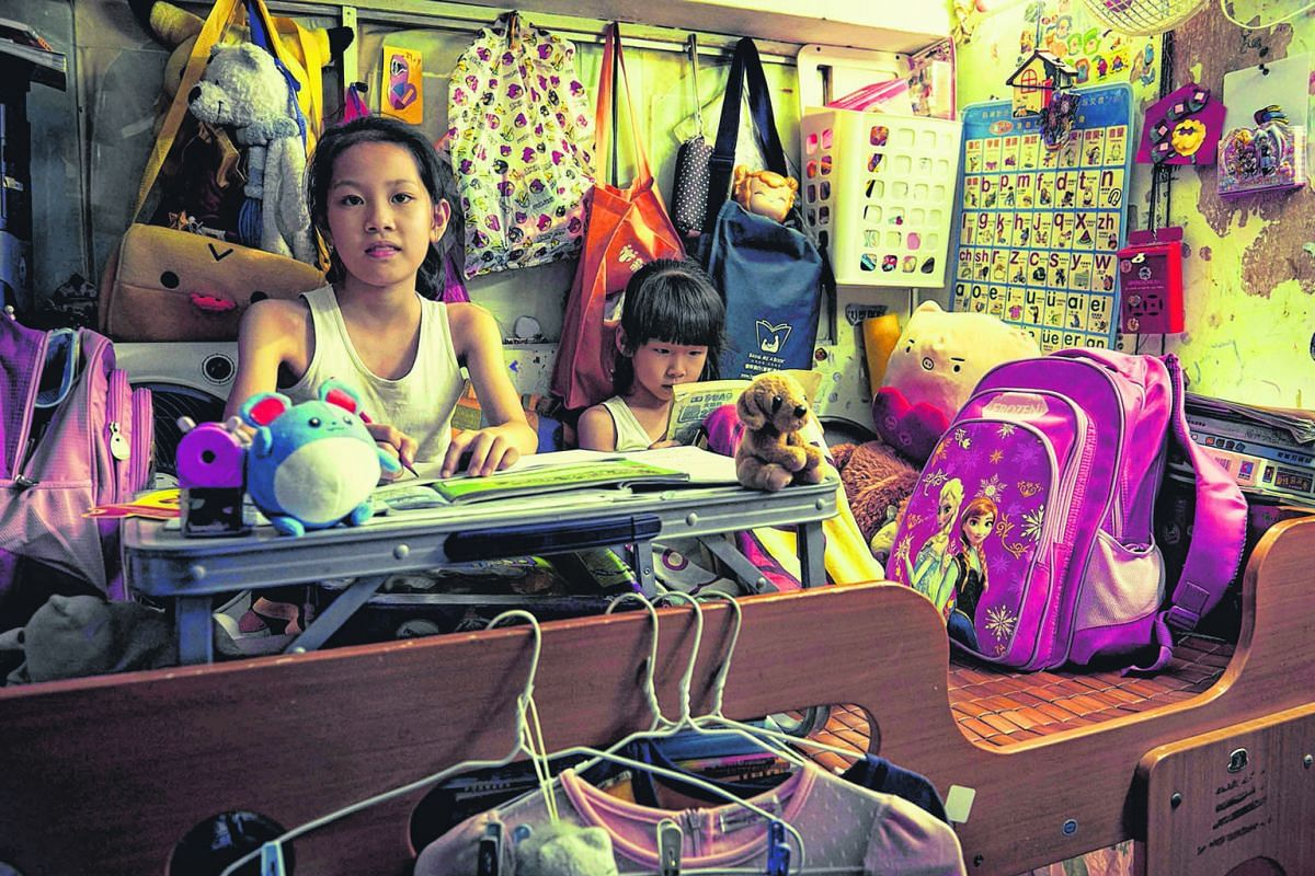 These two girls have to bend over their homework whether they are on the upper or lower deck of their bunk bed. The family, with little income, can afford to live only in a 40 sq ft cubicle that has no window. A study by Hong Kong's Society for Commu