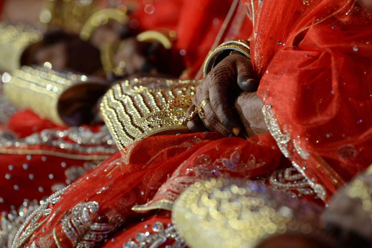 Brides hold onto their purses at a mass marriage in Mumbai on Nov 23, 2016.