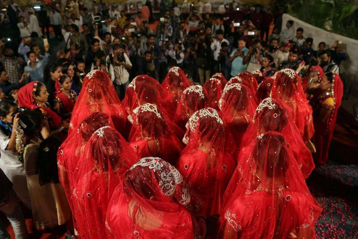 Indian Muslim brides dressed in traditional marriage attire after taking part in a mass marriage ceremony in Mumbai, on Nov 23, 2016.