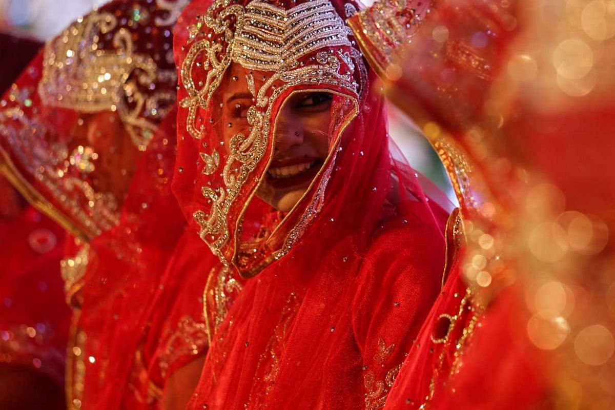 Indian Muslim brides dressed in traditional marriage attire taking part in a mass marriage ceremony in Mumbai, on Nov 23, 2016.