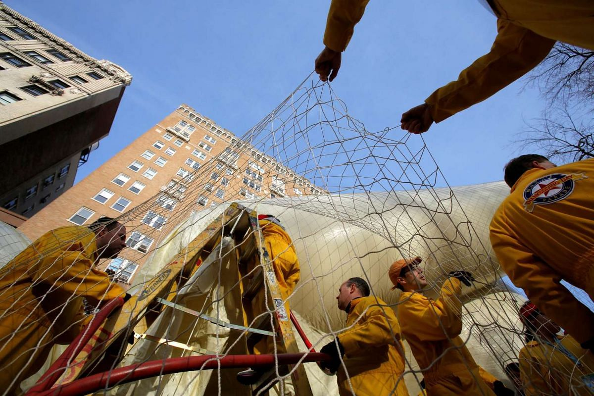 Members of Macy's Inflation Team work on a balloon ahead of the 90th Macy's Thanksgiving Day Parade in New York, on Nov 23, 2016.
