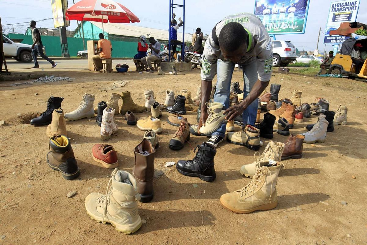 A second hand shoe seller displays his products in Monrovia, Liberia on Nov 23, 2016. Many Liberians buy their footwear second hand, as over 60 per cent of the country lives below the poverty line.