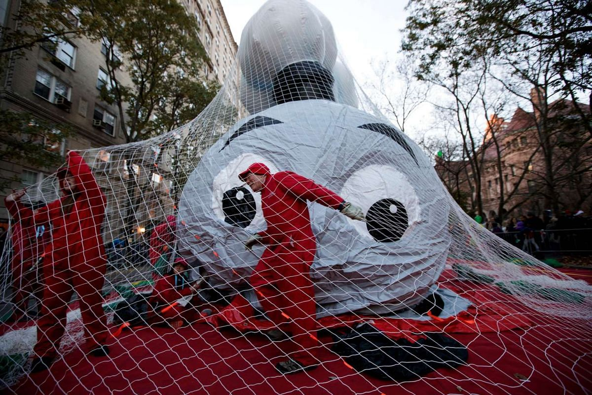 Volunteers help prepare the Thomas the Tank Engine balloon prior to Thursday's Macy's Thanksgiving Day Parade, in New York, on Nov 23, 2016.