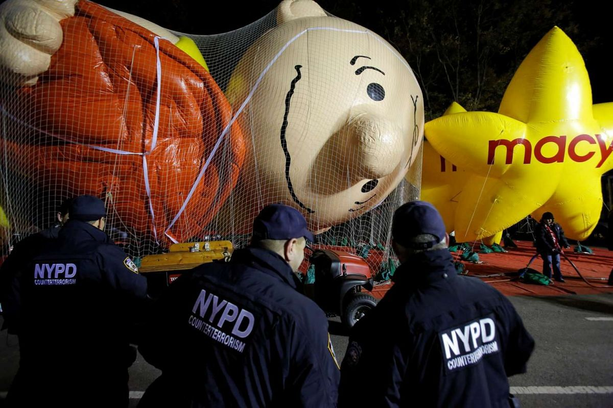 Members of the New York Police Department's Counterterrorism Bureau watch as preparations are made ahead of the 90th Macy's Thanksgiving Day Parade in Manhattan, New York on Nov 23, 2016.