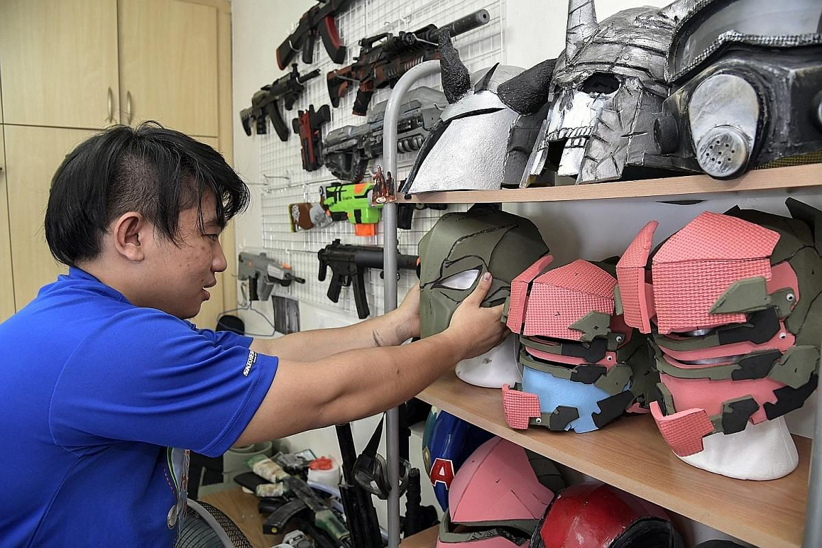 """Mr Yip picks up supplies at an arts and crafts store for his costumes. He buys """"wiggle eyes"""", then paints them black and uses them as studs and rivets on helmets and armour plates."""