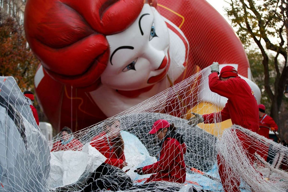 Volunteers help prepare the Thomas the Tank Engine balloon prior to Thursday's Macy's Thanksgiving Day Parade in New York City on Nov 23, 2016.