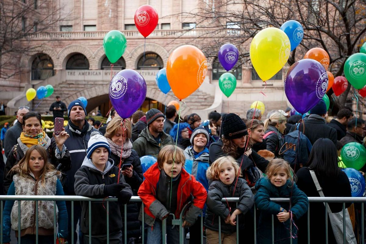 Children and adults watch as balloons are inflated and prepared prior to Thursday's Macy's Thanksgiving Day Parade in New York City on Nov 23, 2016.