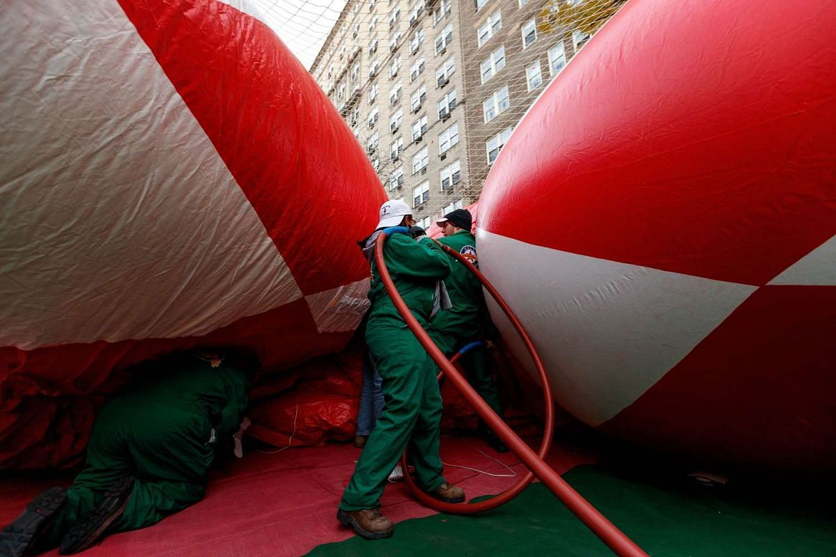 Volunteers inflate the Power Ranger balloon prior to Thursday's Macy's Thanksgiving Day Parade, November 23, 2016 in New York City on Nov 23, 2016.