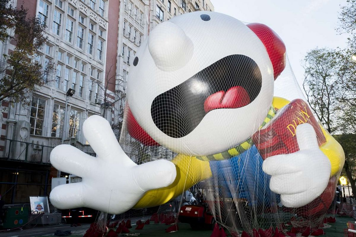 Sandbags and a net hold down a Wimpy Kid balloon the afternoon before the 90th annual Macy's Thanksgiving Day Parade in New York on Nov 23, 2016.