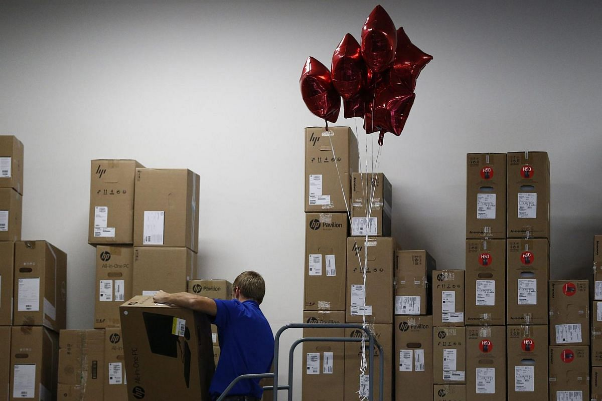A Best Buy employee takes down stock from shelves at the Best Buy store in Mesquite, Texas, US, on Nov 24, 2016.