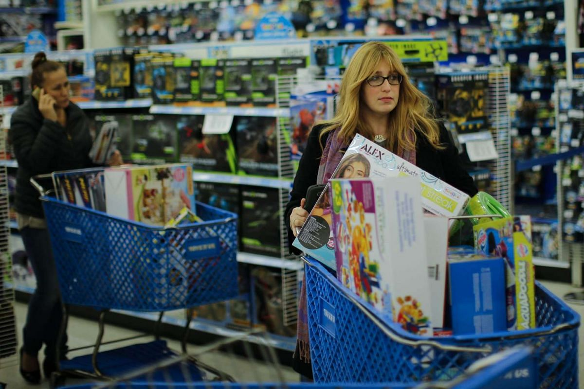 Shoppers buy gifts at the Toys'R'Us store during early Black Friday events on Nov 24, 2016, in Paramus, New Jersey.
