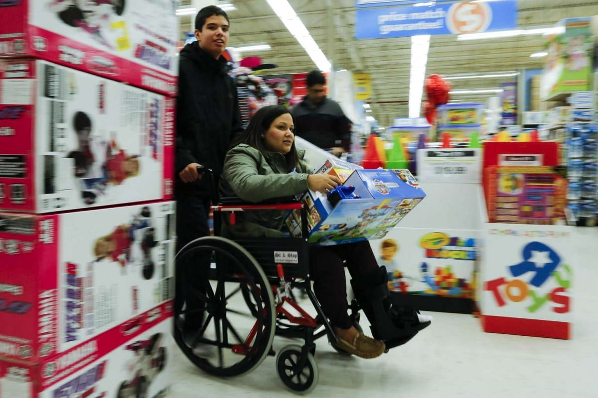Shoppers buy gifts at the Toys'R'Us store during early Black Friday events, on Nov 24, 2016, in Paramus, New Jersey.