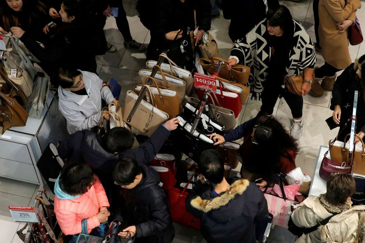 People looking at a rack of handbags during early Black Friday sales at Macy's Herald Square in Manhattan, New York, US, on Nov 24, 2016.