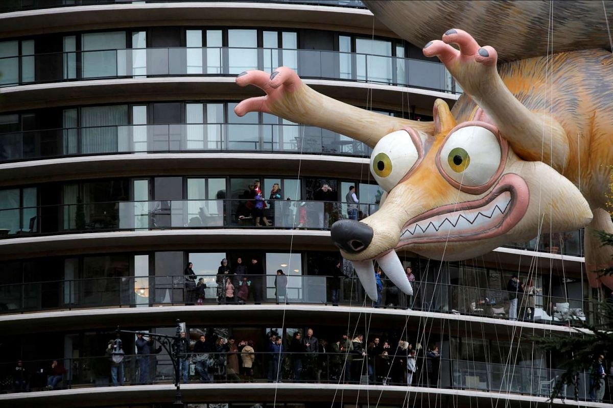 Ice Age's Scrat balloon is carried by crowds gathered on terraces along West 59th Street during the 90th Macy's Thanksgiving Day Parade in Manhattan, New York, on Nov 24, 2016.