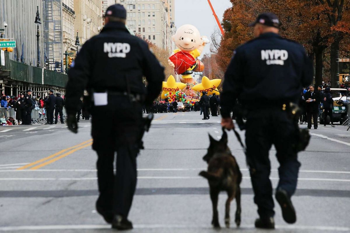 NYPD officers patrol the street as people arrive to watch the 90th Macy's Annual Thanksgiving Day Parade on Nov 24, 2016 in New York City.