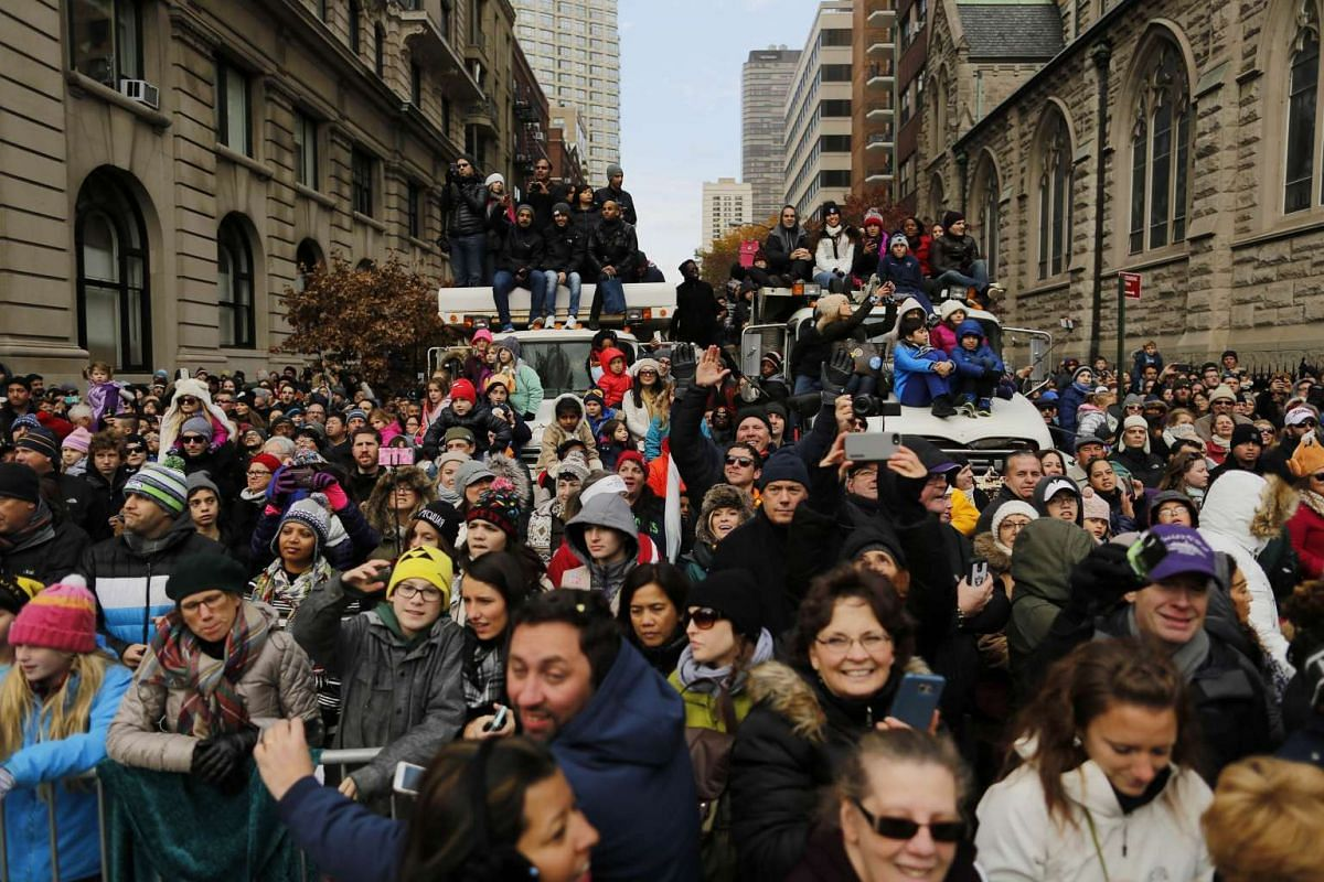 People use the trucks blocking the entrance to protect spectators for watching the 90th Macy's Annual Thanksgiving Day Parade on Nov 24, 2016 in New York City.