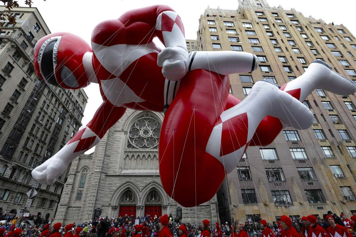 Red Mighty Morphin Power Ranger balloon floats down Central Park West in the Macy's 90th Annual Thanksgiving Day Parade in New York, New York, on Nov 24, 2016.