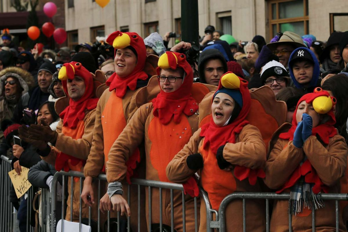 People watch the 90th Macy's Annual Thanksgiving Day Parade on Nov 24, 2016 in New York City.