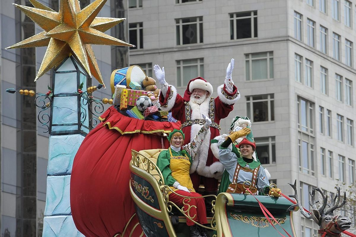 Santa Clause waves from his float in the 90th Macy's Thanksgiving Day Parade in New York, on Nov 24, 2016.