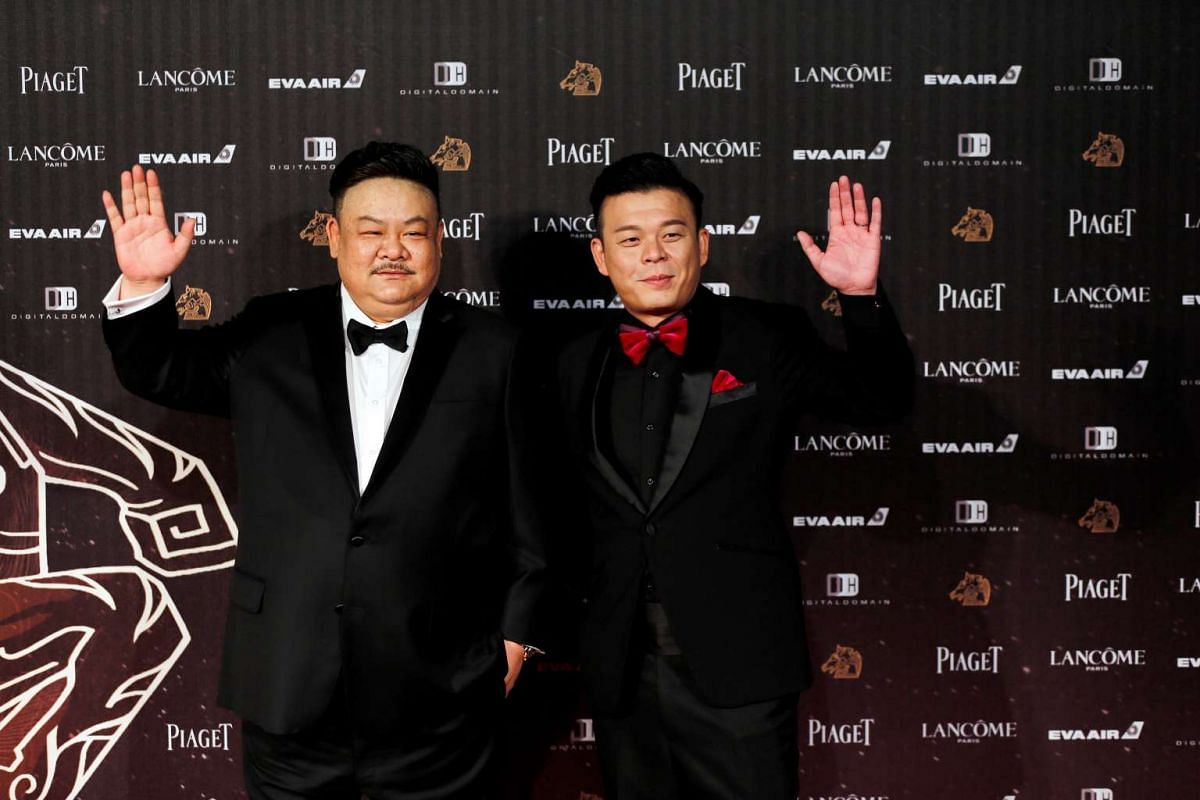 Actor Lam Suet (left) and screenwriter Fire Lee pose on the red carpet at the 53rd Golden Horse Awards in Taipei on Nov 26, 2016.