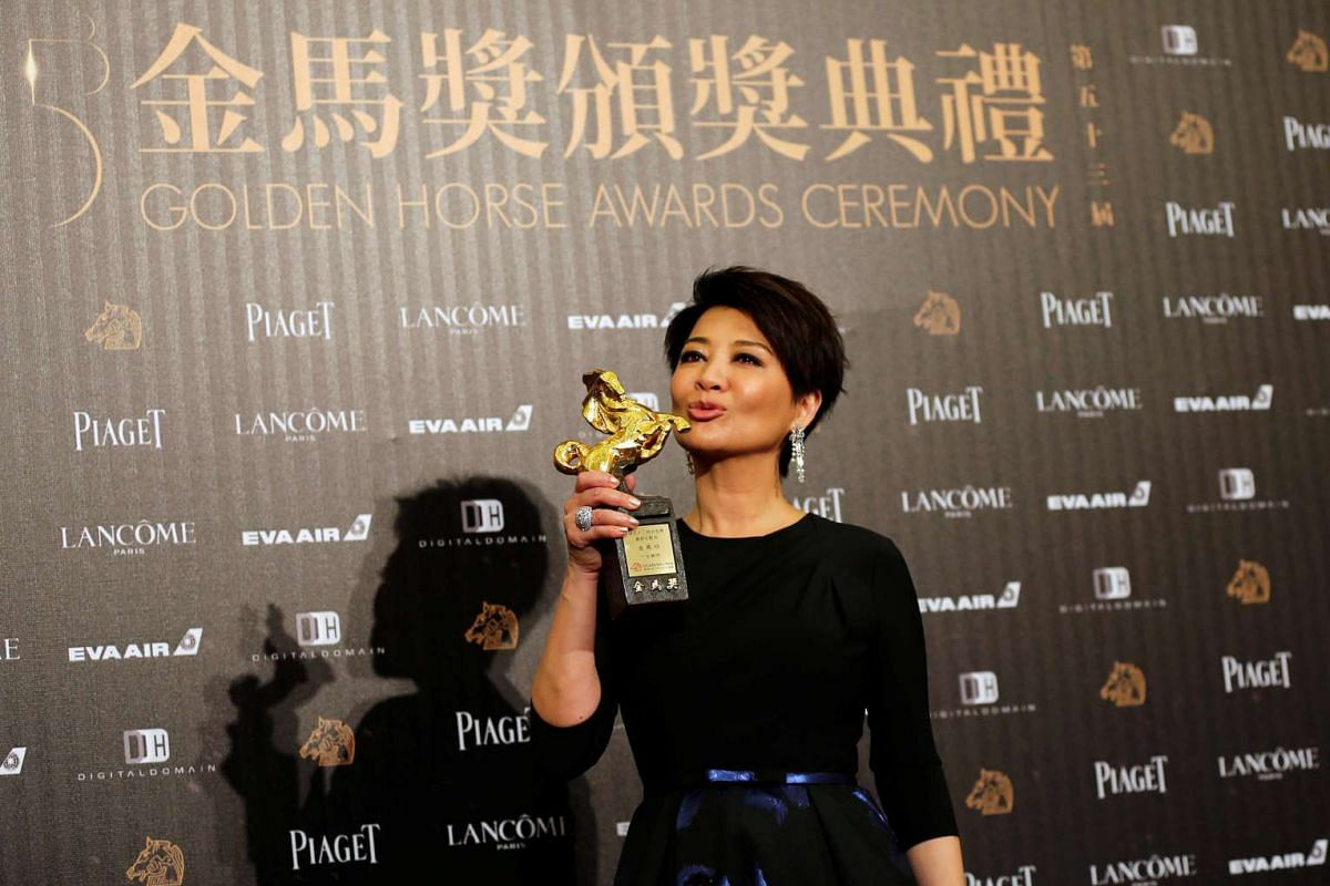 Actress Elaine Jin poses backstage after winning Best Supporting Actress for her movie Mad World at the 53rd Golden Horse Film Awards in Taipei, Taiwan on Nov 26, 2016.