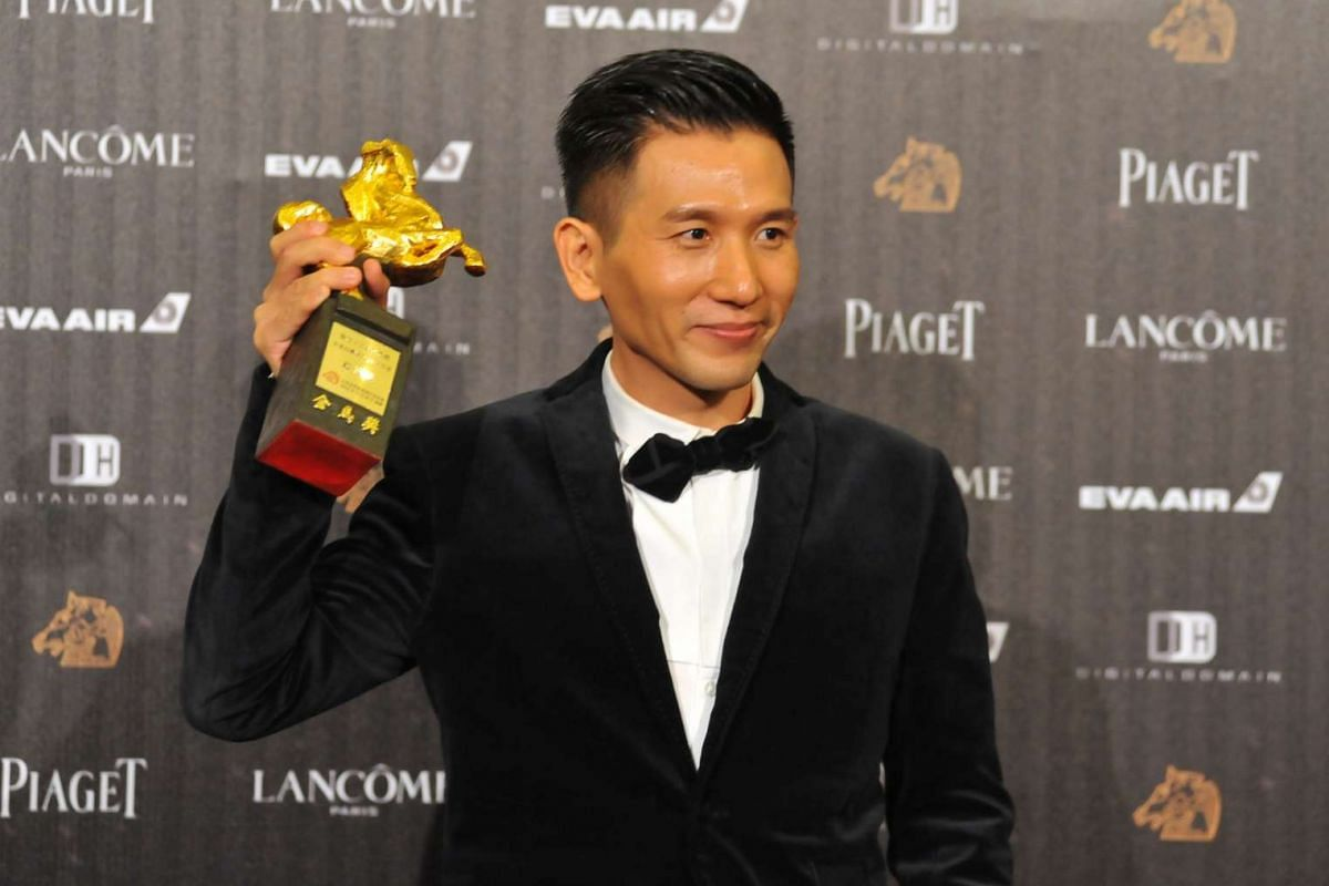 Taiwan director Midi Z displays a trophy after winning the Outstanding Taiwanese Filmmaker of the year during the 53rd Golden Horse Film Awards in Taipei on Nov 26, 2016.