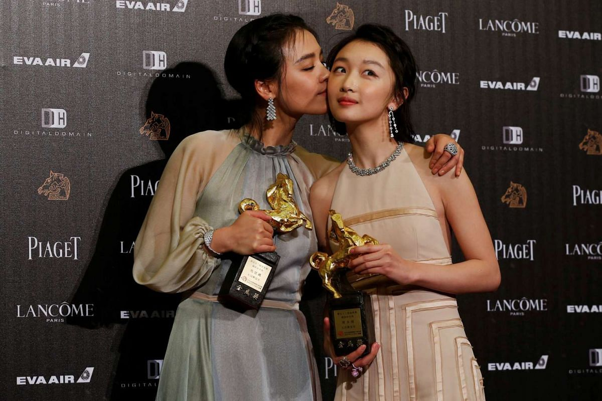 Ma Sichun (left) kisses Zhou Dongyu after they both won the Best Leading Actress award for their movie Soul Mate at the 53rd Golden Horse Film Awards in Taipei, Taiwan on Nov 26, 2016..