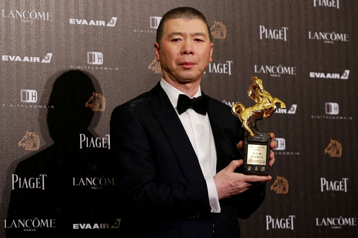 Director Feng Xiaogang poses backstage after winning the Best Director award for his movie I Am Not Madame Bovary at the 53rd Golden Horse Film Awards in Taipei, Taiwan, Nov 26, 2016.
