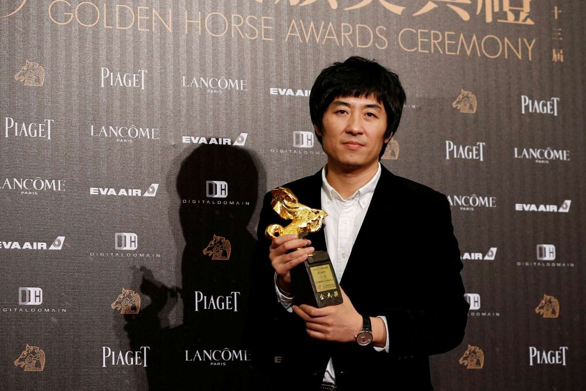 Director Zhang Dalei poses backstage after winning the Best Feature Film award for his movie The Summer is Gone at the 53rd Golden Horse Film Awards in Taipei, Taiwan, Nov 27, 2016.