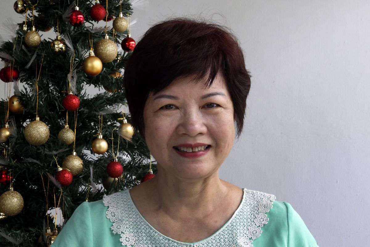 Housewife Rose Eng bakes her rum-soaked fruit cake for family and church friends every year.