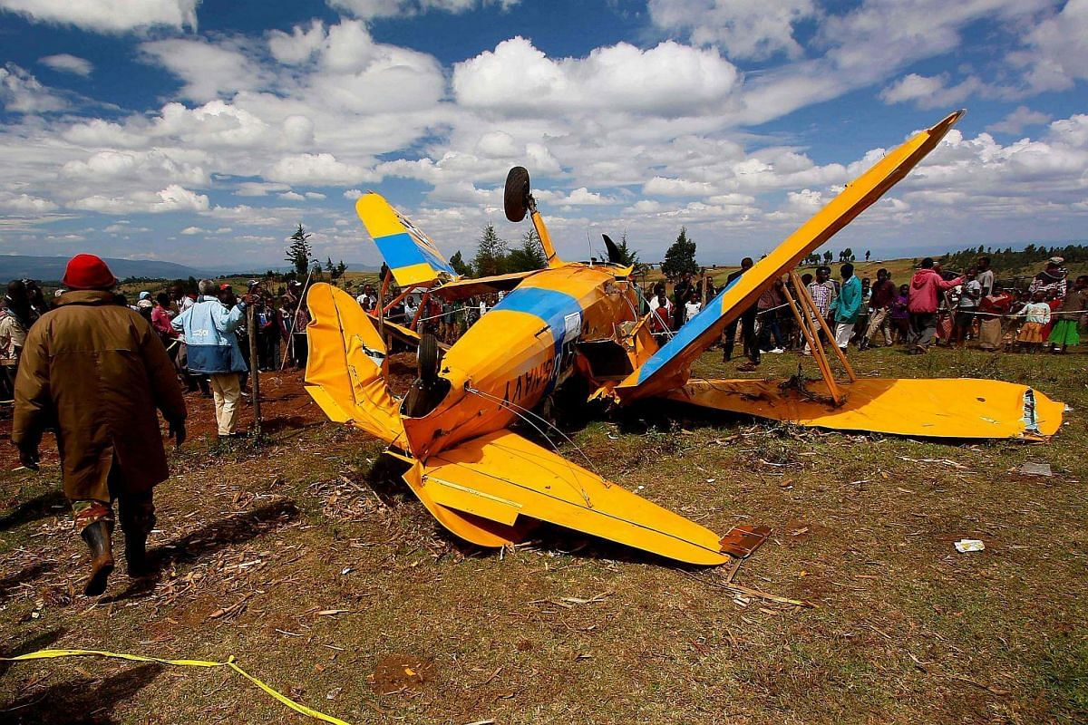 People stand around the wreckage of a 1941 Boeing Stearman in Molo, Nakuru on Nov 27, 2016.