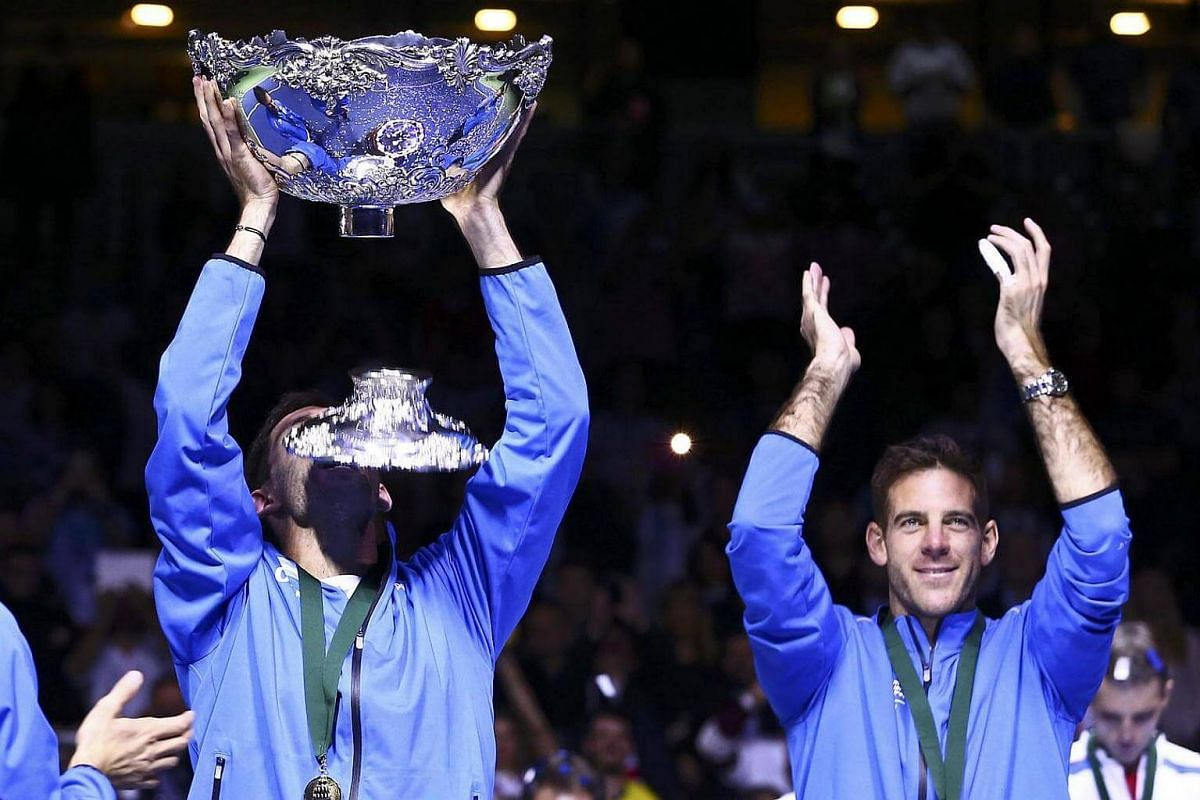 Argentina's Federico Delbonis and Juan Martin del Potro react after winning the final of the Davis Cup.