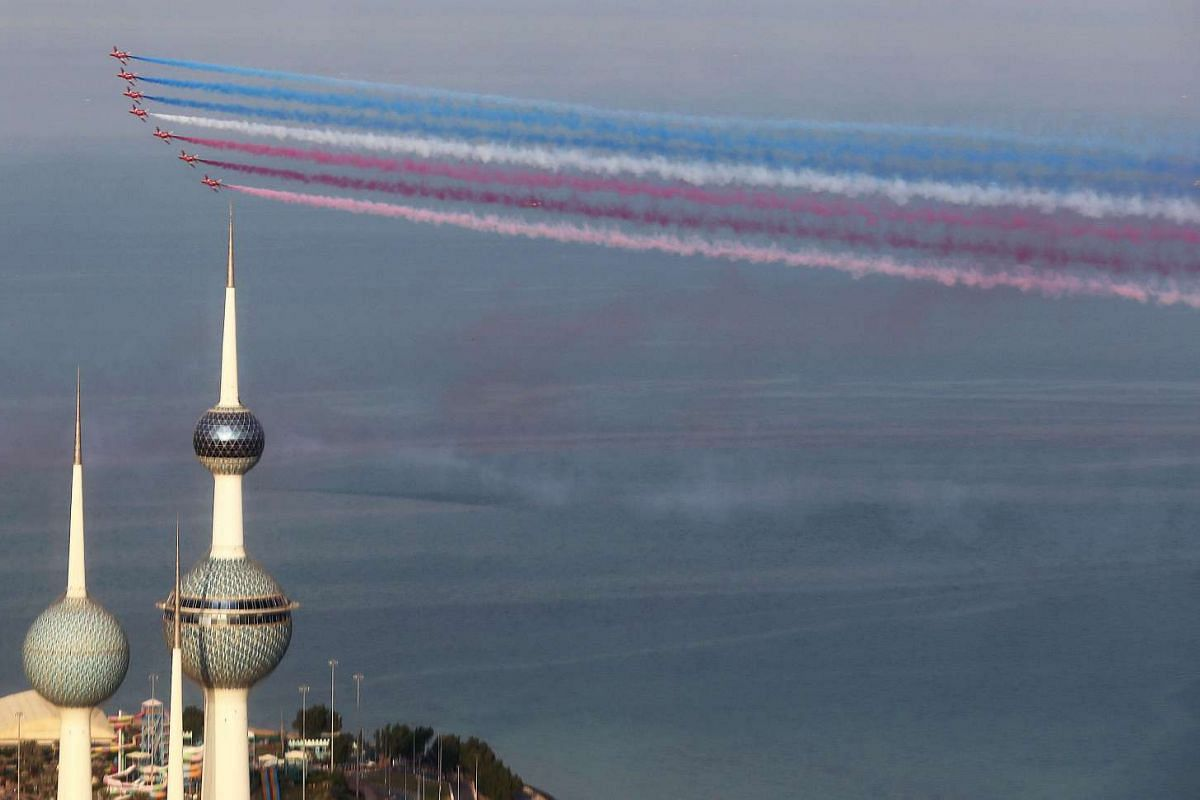 A picture taken from the Hamra Tower, the highest building in Kuwait, shows Britain's Royal Air Force (RAF) aerobatic team, The Red Arrows, performing during a show in Kuwait City, on Nov 28, 2016.