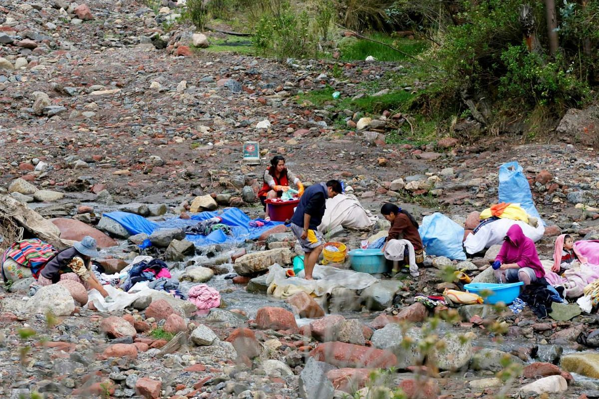 People doing laundry in the Palca river during a water drought season in Palca near La Paz, Bolivia, on Nov 28, 2016.