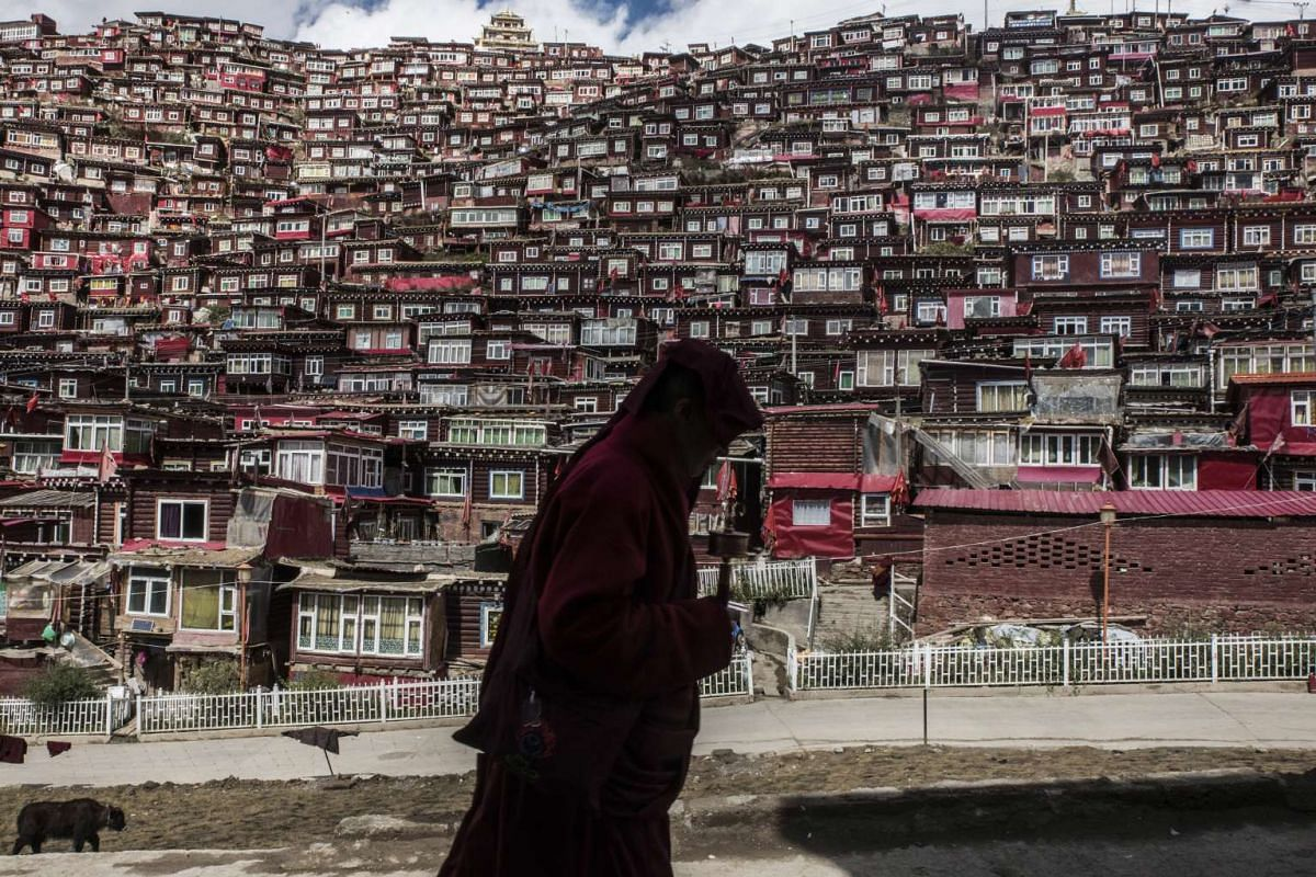 A Buddhist nun with a prayer wheel in Larung Gar, China, on Oct 8, 2016.