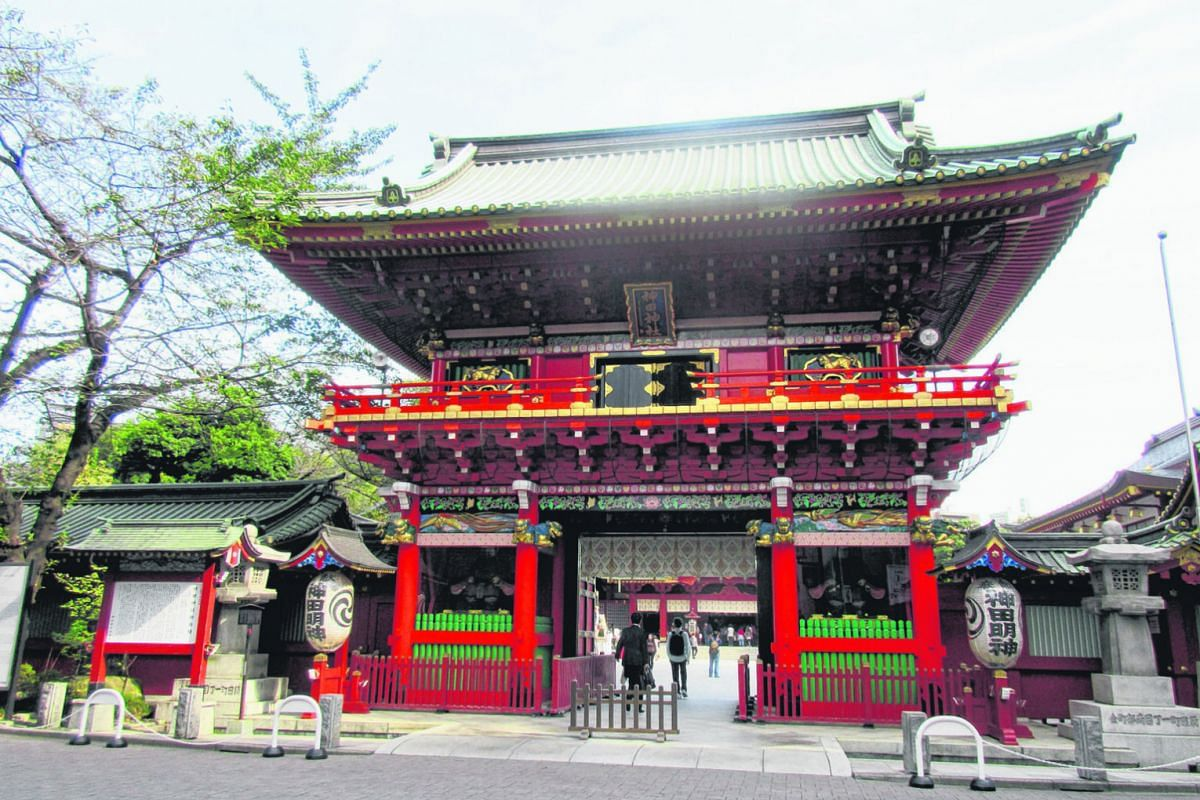 The Kanda Myojin shrine in Tokyo (top and above), a 1,300-year-old Shinto sanctuary, is nicknamed Anime Shrine because two popular anime series - LoveLive! and Etotama - are set there. French tourist Geoffray Fortin (above), 30, looking at robots of
