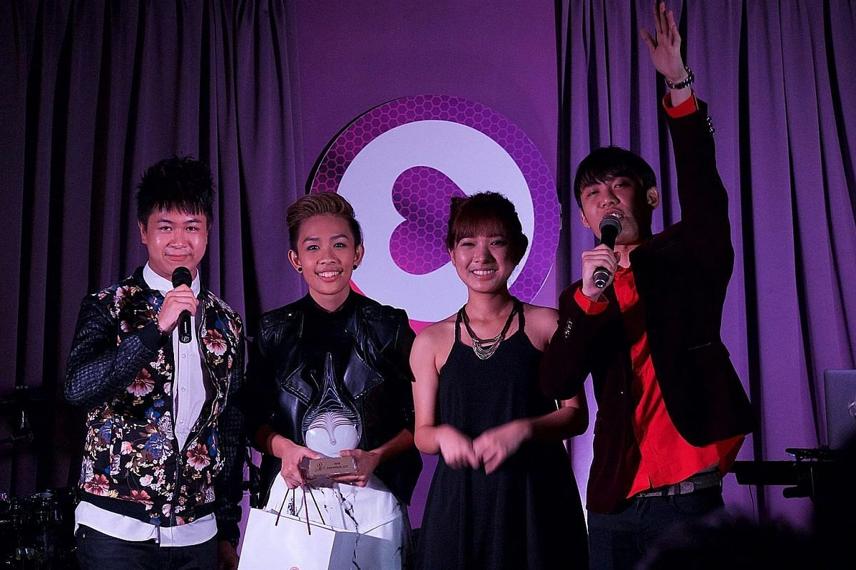 Jean Goh (second from far left) won mm2's first Hear Me Sing contest. With her are hosts Maxi Lim (far left) and Wang Weiliang and first runner-up Yokez.