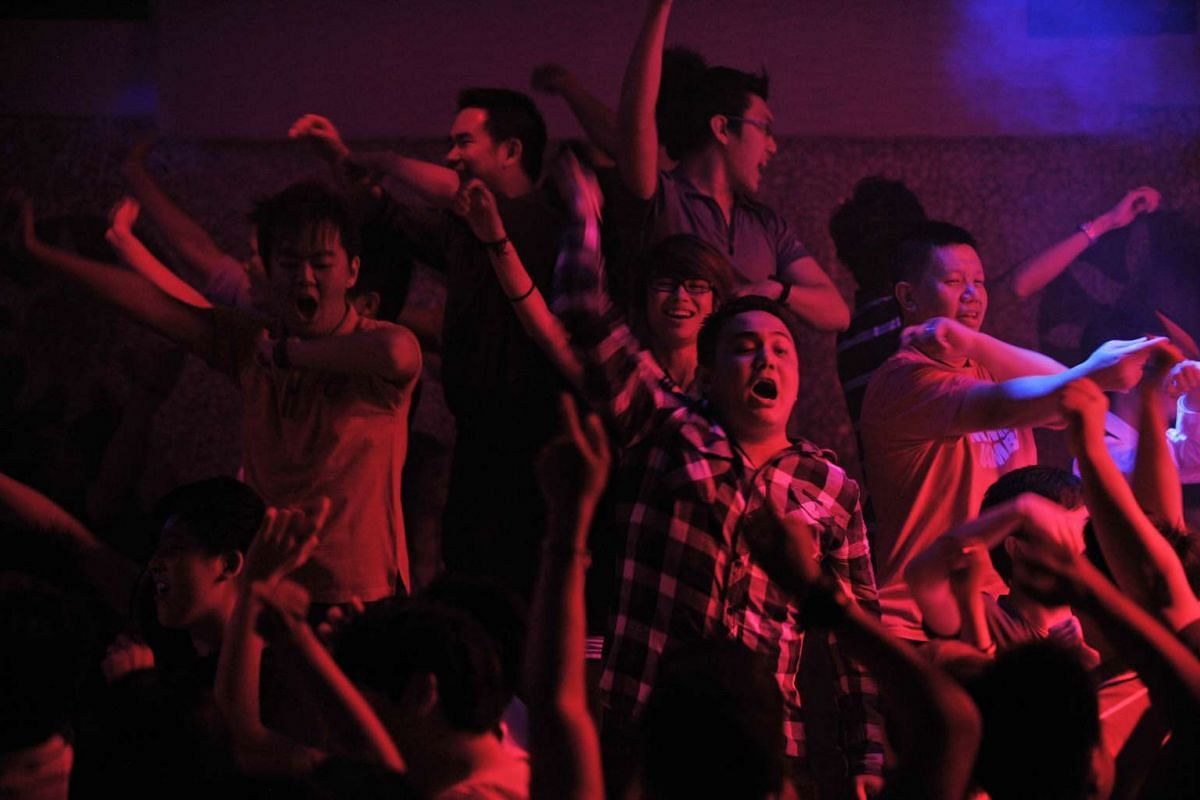 Partygoers dance to 80s music at Zouk during one of their Mambo Jambo retro music nights in April 2011, as the club celebrates its 20th anniversary.