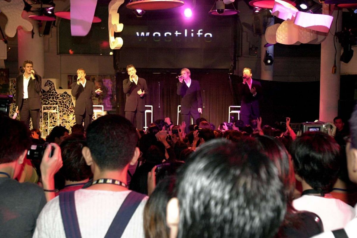 Westlife performs during a press conference and showcase at Zouk in November 2000.