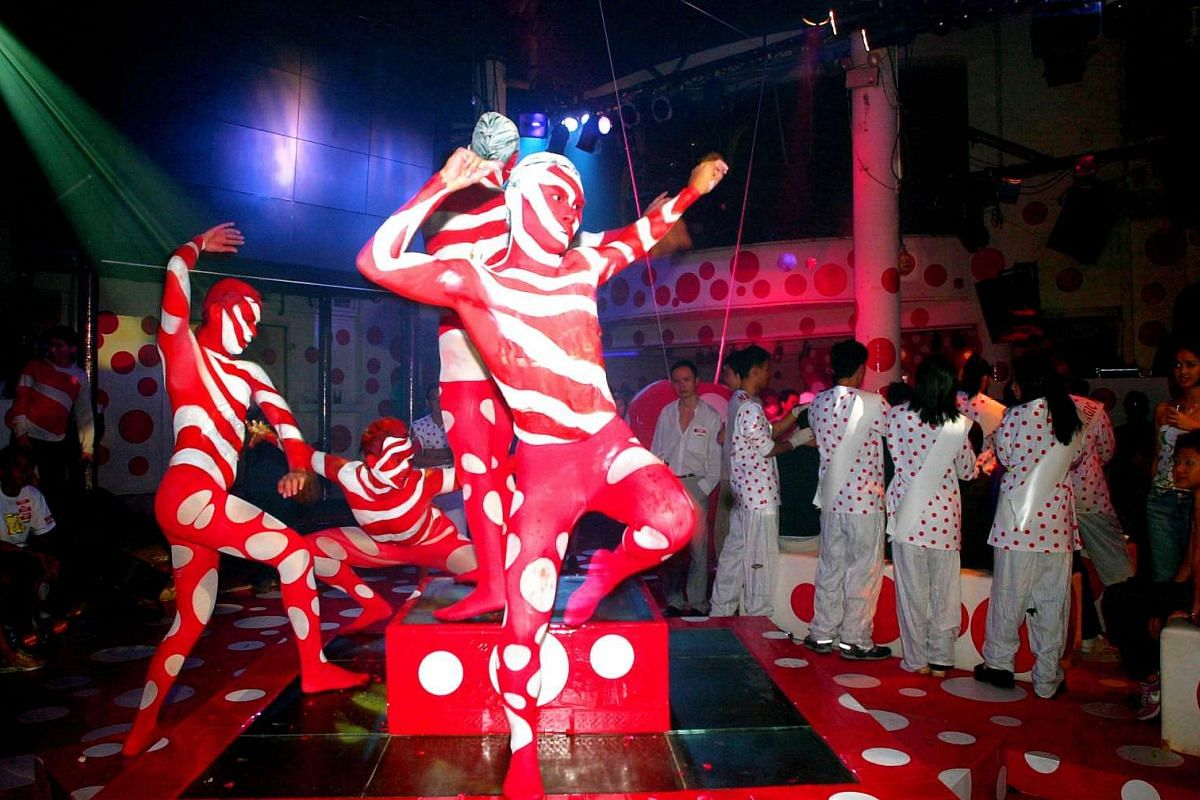 Mime artists perform at Zouk in 2002.