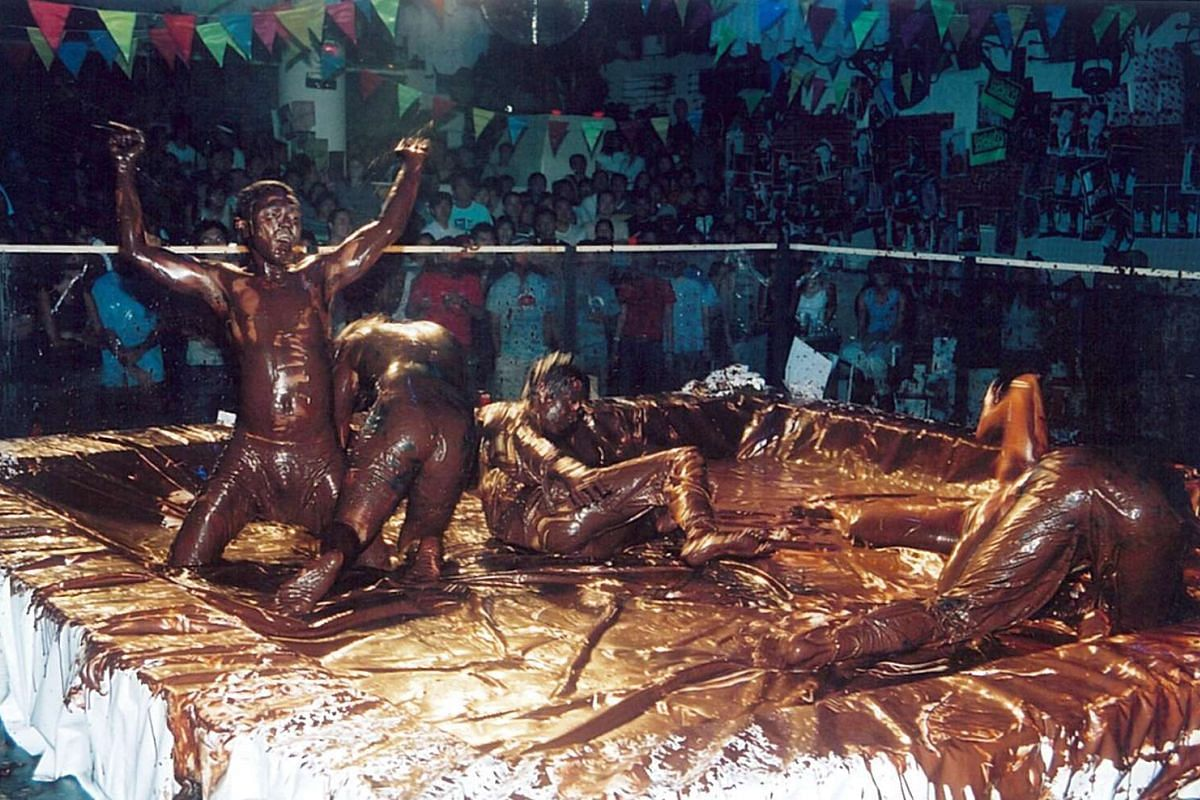 Patrons cover themselves in mud for Zouk's mud-wrestling themed party in 2007.
