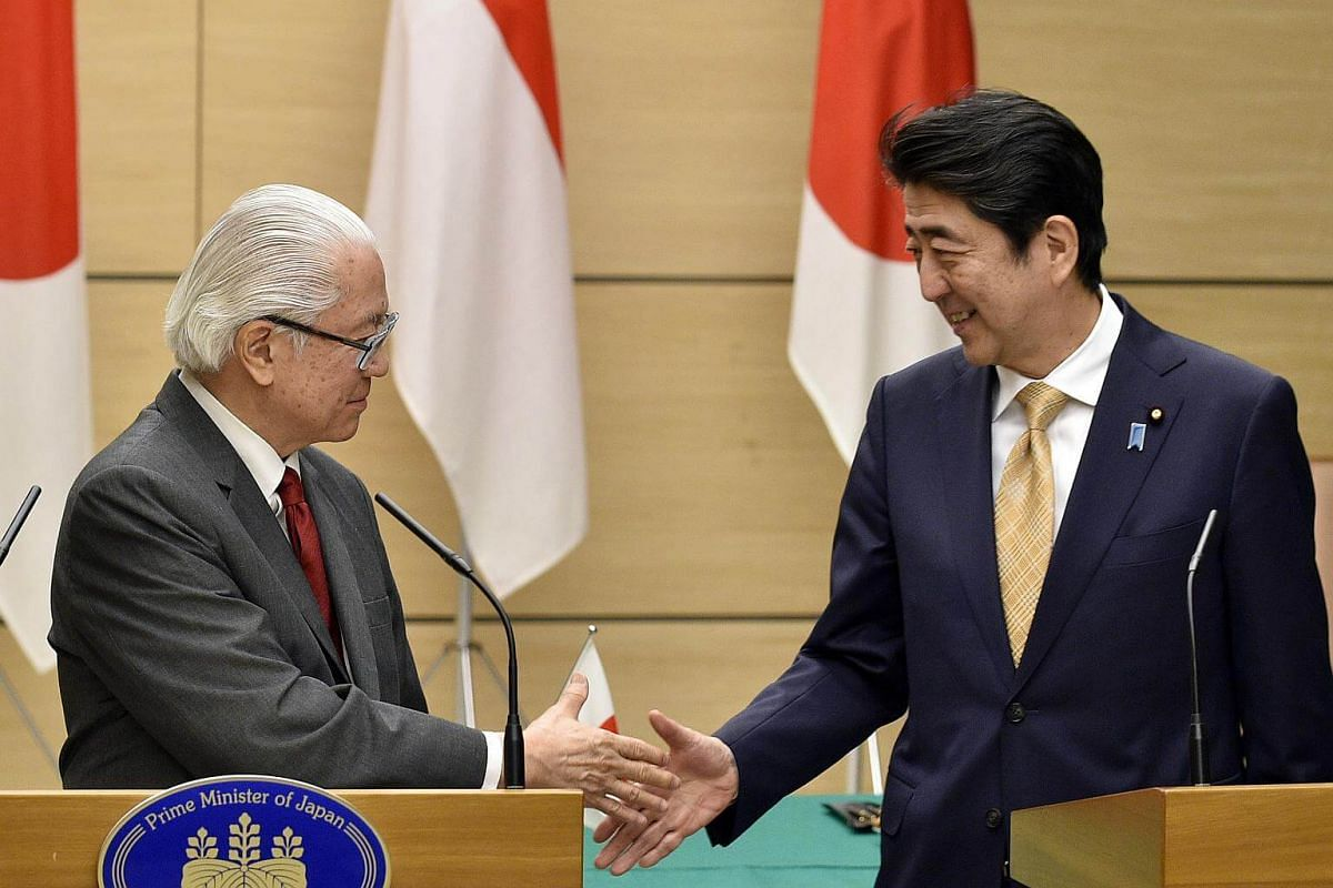 Dr Tan (left) shaking hands with Mr Abe after a joint press conference at the latter's official residence in Tokyo on Dec 1, 2016.