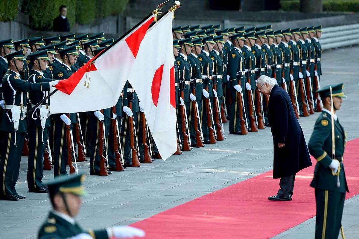 Dr Tan meeting the guard of honour at the welcoming ceremony at the Imperial Palace in Tokyo on Nov 30, 2016.