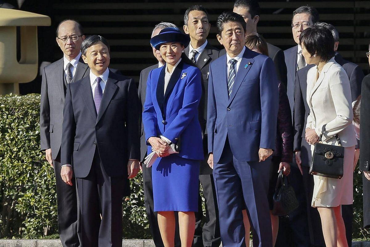 (From left) Japan's Crown Prince Naruhito and Crown Princess Masako with Prime Minister Shinzo Abe and wife Akie Abe at the welcoming ceremony at the Imperial Palace in Tokyo on Nov 30, 2016.